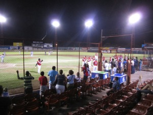 The fans raise to their feet and the Granada Orientales leave the dugout as they celebrate two much needed runs in the 5th inning