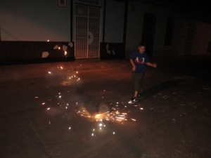 Ton (my little Nica brother) lighting off a bunch of firecrackers.
