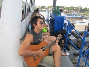 Hugo from Masaya, Nicaragua plays the guitar as we wait for our boat to depart from Bluefields and begin the journey to Big Corn Island