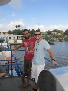 Mariano and I on the boat waiting on our boat with a bit of Bluefields in the background.