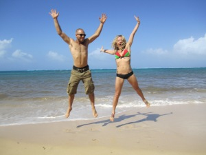 Aaron and Lexi jumping for joy near that beautiful Carribean Sea