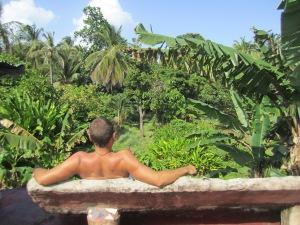 Enjoying the view of the jungle from the bench on the roof of our house at Ensuenos