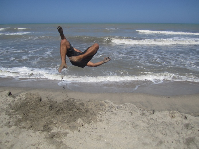 Will snapped some awesome shots of me as I was jumping off the sand ledges created by the waves.