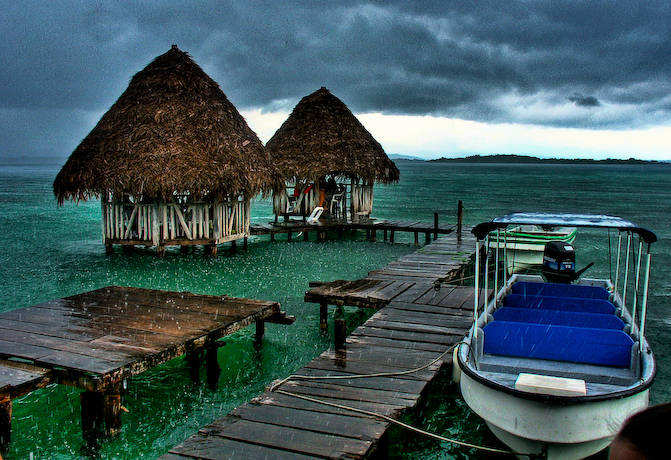 I quickly stopped at the hostel with my private boat on my way to the reef break in order to hire a surfboard for the day. Even in the rain it is paradise here on Isla Colon in Bocas del Toro