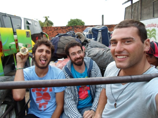Here is Agustin of Argentina, Christian of Switzerland, and myself in the back of the pick-up getting ready for hour 4 hour ride to Yurimaguas in the pouring rain
